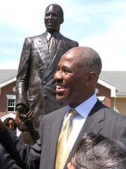 Then-Memphis mayor Willie Herenton stands in front of his statue on Walker Avenue in 2003.
