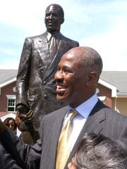 Then-Memphis mayor Willie Herenton stands in front of his statue on Walker Avenue in 2003.