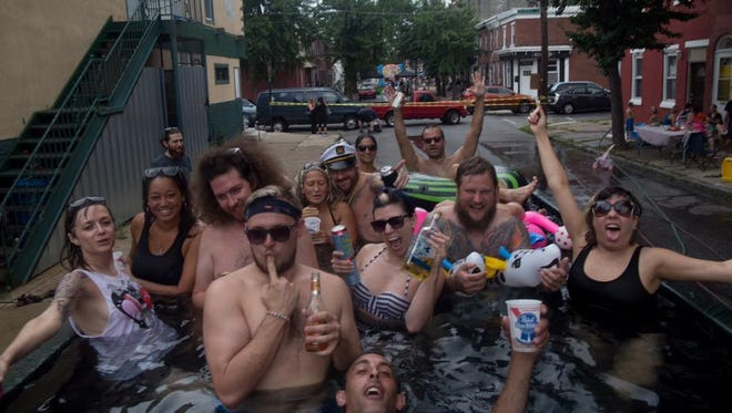 The city of Philadelphia is asking people to refrain from swimming in dumpsters after a block party rented trash bin and turned it into a makeshift swimming pool over the weekend.
