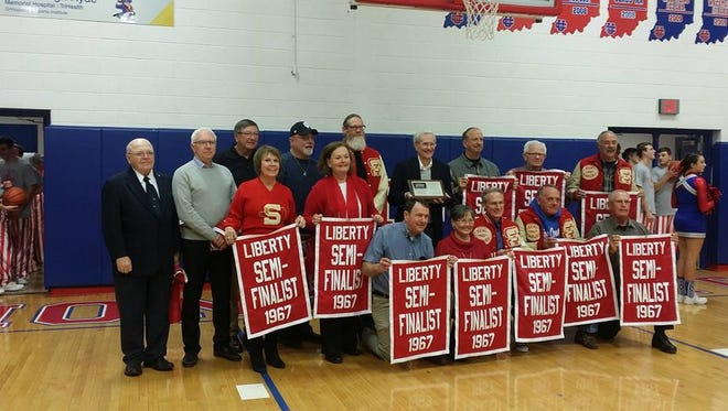 Members of the 1967 Liberty Lancers basketball team.