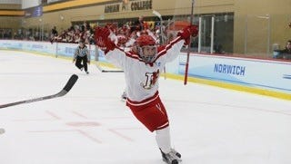 Kayla Meneghin celebrating after scoring in the semifinal win over Norwich University.