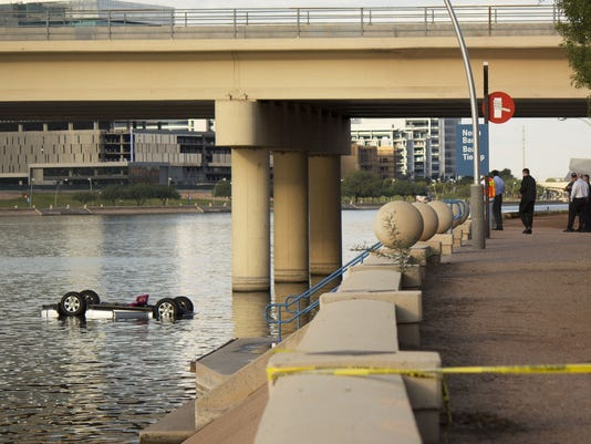 SUV in Tempe Town Lake