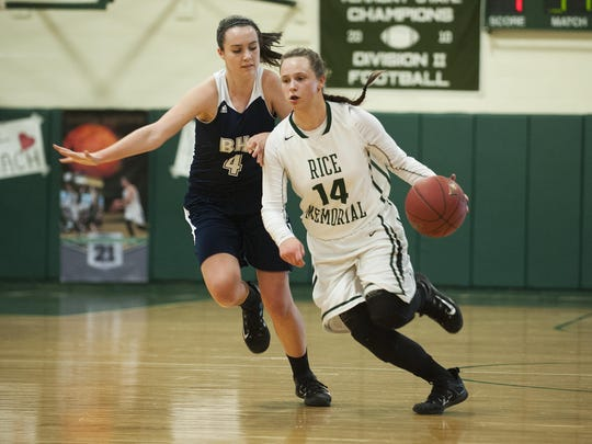 Rice's Lisa Sulejmani (14) dribbles the ball down the court during a high school girls basketball game last season.