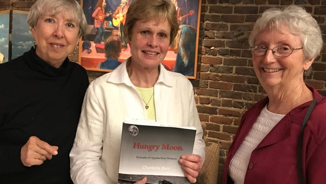 """Among the guests at the """"house"""" party to benefit a project of Marie Cirillo's were, from left, Christine Scheutzow Griffin, Pat Pennebaker and Sue Stephens."""