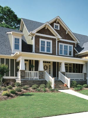 A wide porch welcomes you to this Craftsman home.