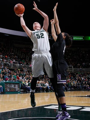 Michigan State's Becca Milla (52) shoots against Northwestern's Lauren Douglas Sunday, Dec. 28, 2014, in East Lansing, Mich. Mills led MSU with 21 points and 16 rebounds.