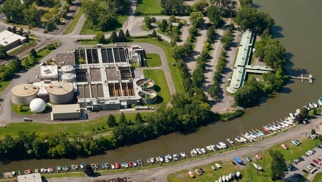Workers at the Ithaca Area Wastewater Treatment Facility are studying their ability to remove plastic microbeads and non-regulated chemicals from waste water. The plant, seen here in August of 2014, is located on Cascadilla Creek, bottom, next to the Ithaca Farmers Market, right.