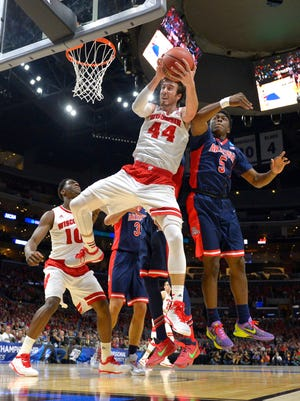 Wisconsin's Frank Kaminsky (44) grabs a rebound in front of Arizona's Stanley Johnson (5) during the first half of a college basketball regional final in the NCAA Tournament, Saturday, March 28, 2015, in Los Angeles. (AP Photo/Mark J. Terrill)