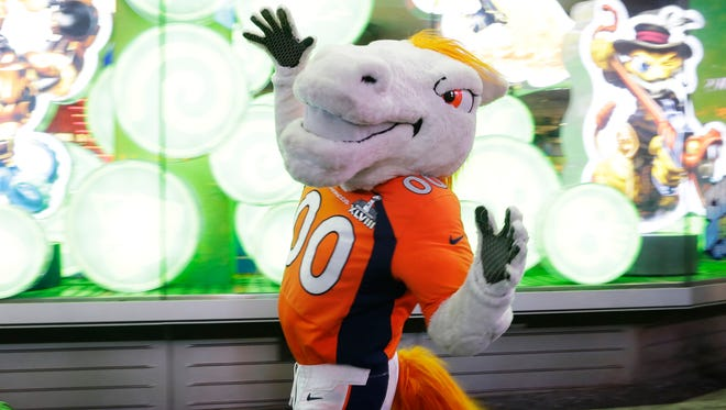 Miles, the Denver Broncos mascot, walks through Times Square, Friday, Jan. 31, 2014 in New York. The Seattle Seahawks will play the Broncos Sunday in the NFL Super Bowl XLVIII football game in East Rutherford, N.J. (AP Photo/Ted S. Warren)