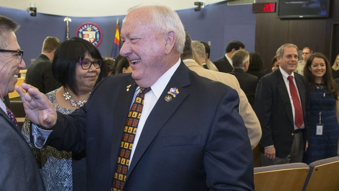 Former state lawmaker Russell Pearce, seen here at the swearing-in ceremony Jan. 4 of Maricopa County officials, was promoted from technology and customer service director to chief deputy treasurer and will get a $70,000 raise.