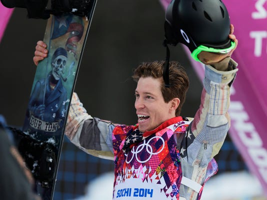 FILE - In this Feb. 11, 2014, file photo, Shaun White of the United States waves to the crowd after a run during the men's snowboard halfpipe qualifying at the Rosa Khutor Extreme Park, at the 2014 Winter Olympics in Krasnaya Polyana, Russia. White says there were times in the weeks after he slammed his face into a halfpipe in New Zealand and had to be helicoptered off the mountain when he wondered what was to be learned from it all. To outsiders, the answer is simple. The accident served as a jarring reminder of the hurdles White was willing to overcome to make it back to the Olympics, and this time, to leave with a third gold medal.  (AP Photo/Andy Wong, File)