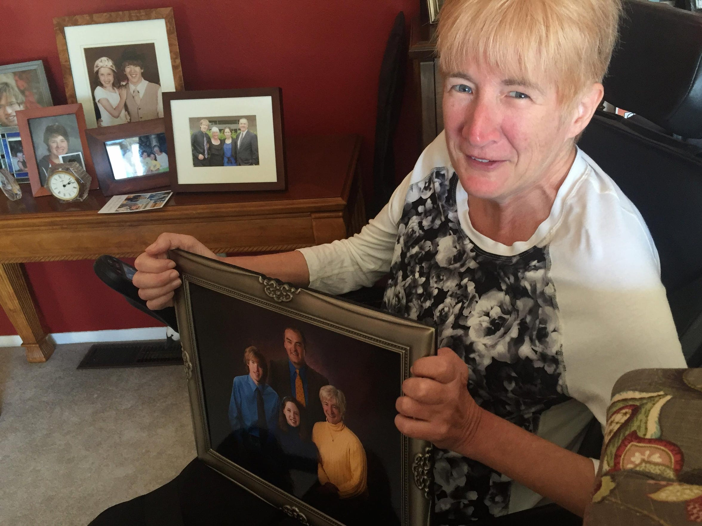 Pam Hillery holds a family portrait in her Havre home. She said she worries about what will become of her family when she's gone but also knows they have strong, loving relationships to sustain them.