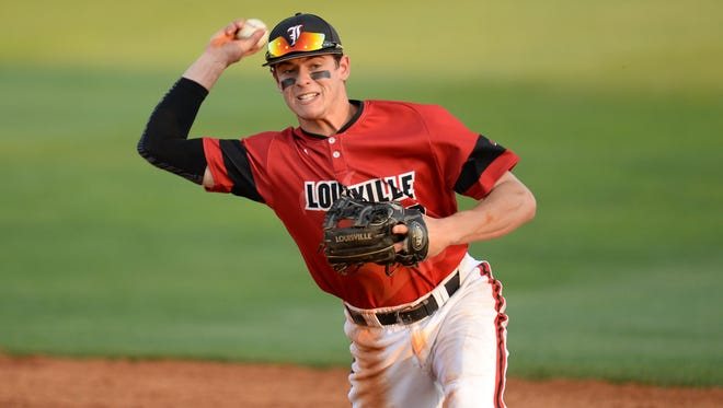 U of L second baseman Nick Solak throws to first base during the University of Louisville vs. University of Kentucky baseball game last season.