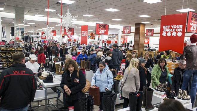 Hundreds of shoppers search for deals on boots, shoes, home goods and more during the first hour of JC Penney's opening sale on Thanksgiving night last year. A recent poll finds the majority of North Carolinians will not be shopping on Black Friday this year.