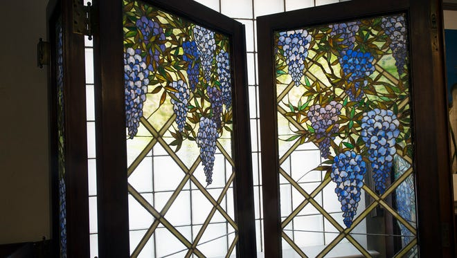 A leaded glass window that came from a home in France, at Keystone Auction LLC.