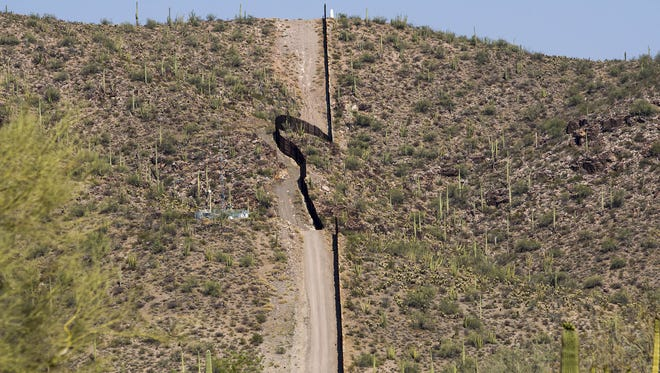A section of the border fence near Ajo, Ariz. President Trump is demanding that money for the border wall be part of any deal to protect young immigrants brought to the U.S. illegally from deportation.