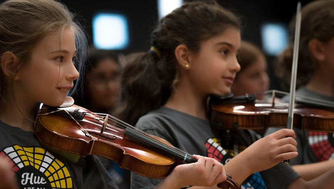 This 2016 photo provided by Old Town School of Folk Music shows students participating in one of Old Town School's summer fiddle camp programs in Chicago, Ill. (Kevin Viol/Old Town School of Folk Music via AP)