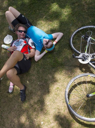 Heath Hanlin and his fianc? Molly Flaherty stop and enjoy a break in the midway town, Clear Lake. They live in Syracuse, NY, but are from Davenport and met on RAGBRAI. This is Heath's 5th ride and Molly's 6th. The beautiful day on RAGBRAI was enjoyed by all during their stop in Clear Lake on their way to Mason City. Many took advantage of the Lake.