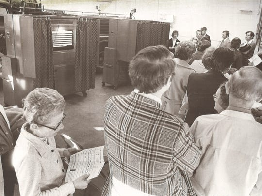 Prior to the current early voting system, which was enacted in 2005, voters could cast ballots on Election Day or via mail. Here, they crowd into the Haw Creek fire station in 1976.