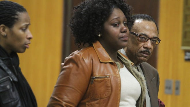 Brenda Hardaway gets comforted by The Rev. Lewis Stewart as she arrvies in court on March 18.