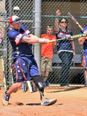 Bath's Brent Nadjadi takes a swing for the Wounded Warrior Amputee Softball Team during a game in April of 2018 in Glassboro, New Jersey.