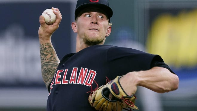 Cleveland Indians starting pitcher Zach Plesac throws during the first inning of a baseball game against the Kansas City Royals Tuesday, Sept. 1, 2020, in Kansas City, Mo.