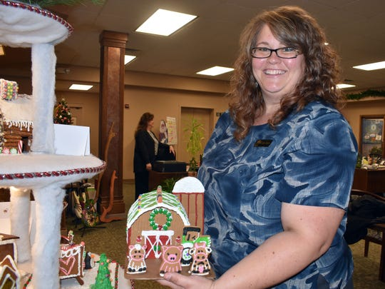 "Jana Gentry, a mortgage loan processor at First National Bank, created ""Country Christmas"" and the proceeds from the silent auction on this gingerbread house will benefit Otero County 4-H."