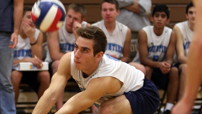 Suffern's Evan Margolin (9) hits the ball during boys volleyball's regional match against Shenendehowa at Clarkstown South High School in West Nyack on November 10, 2016.