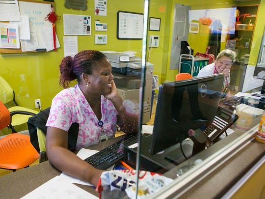 Cynthia Holmes, CNA (left) and Megan Kuhn, RN, work at the nurses' station on the second floor of Exceptional Care for Children in Newark.