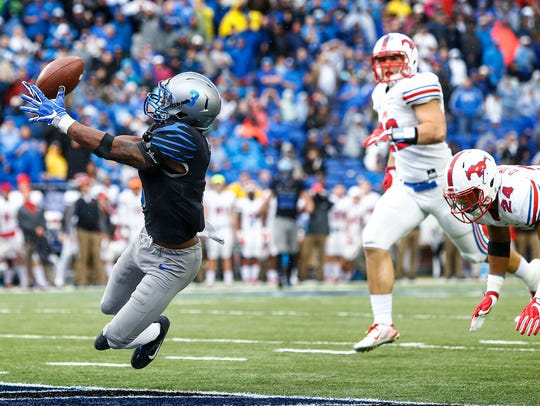 Memphis receiver Anthony Miller (left) grabs a touchdown catch against SMU on Saturday.