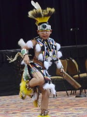 Sinte-Ska Roberts dances the chicken dance in a dance demonstration held during a recent Tunica-Biloxi Tribe Education Day. The tribe is featured in a museum in Marksville.