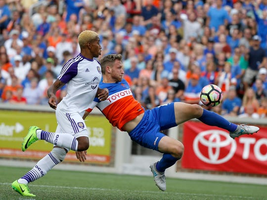 FC Cincinnati Kyle Greig  (16) is knocked down as he attempts to shoot in the first half of the USL soccer match between FC Cincinnati and Orlando City B at Nippert Stadium in Cincinnati on Saturday, Aug. 5, 2017. Despite a goal late in stoppage time, FC Cincinnati settled for a tie against OCB.