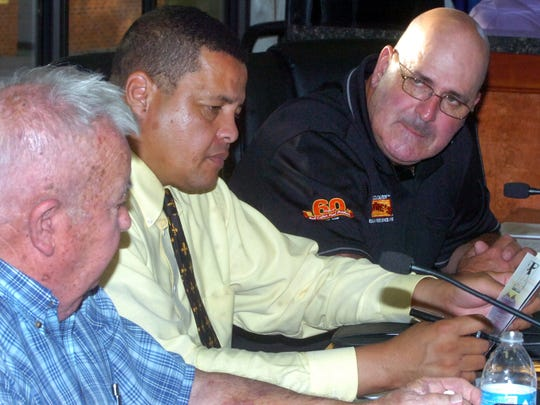 Council members, from left, Ronald Buschel, Dexter Brown and Timmy Lejeune discuss meetings procedures for trash pick-up in St. Landry Parish during a committee meeting earlier this year.