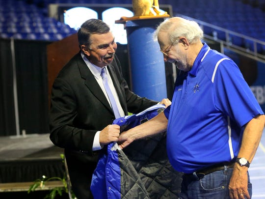MTSU head baseball coach Jim McGuire presents the Railbird Jacket to Dick Palmer on Tuesday, Feb. 2, 2016, during the 43rd annual Groundhog Day luncheon.