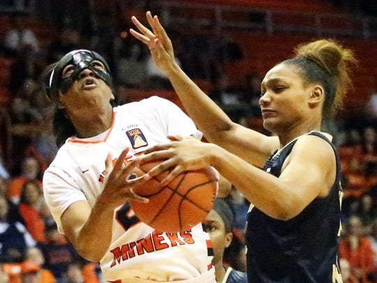 UTEP's Jenzel Nash gets the ball stripped by FIU'S Brianna Wright while driving for the basket Thursday night in the Don Haskins Center. The Miners prevailed 70-52.