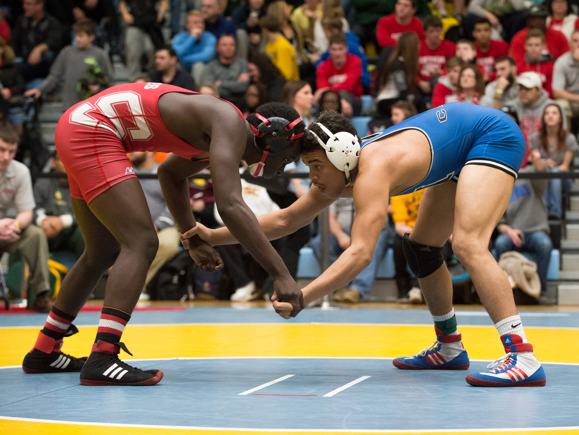 Middletown's Isiah Mitchell, right faces off against Smyrna's Larsen Wilson in the 170 pound quarterfinals at the DIAA Individual State Tournament at Cape Henlopen High School.