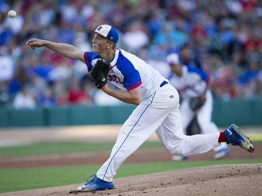 Michael McAvene pitches for Roncalli, as they take on Zionsville High School, in the Class 4A title game from Victory Field, Indianapolis, Friday, June 17, 2016.