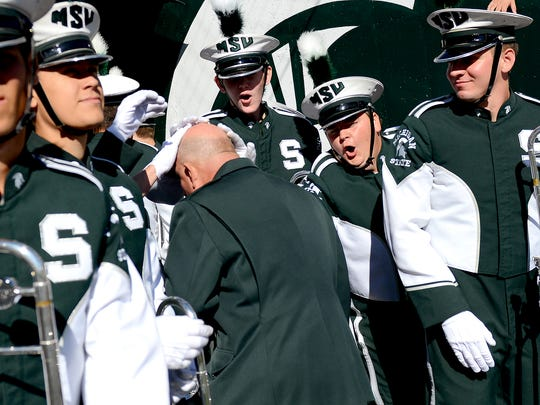 Glenn Brough instructs the Spartan Marching Band on the field at Spartan Stadium before a game Saturday, Oct. 8, 2016 in the  in East Lansing.
