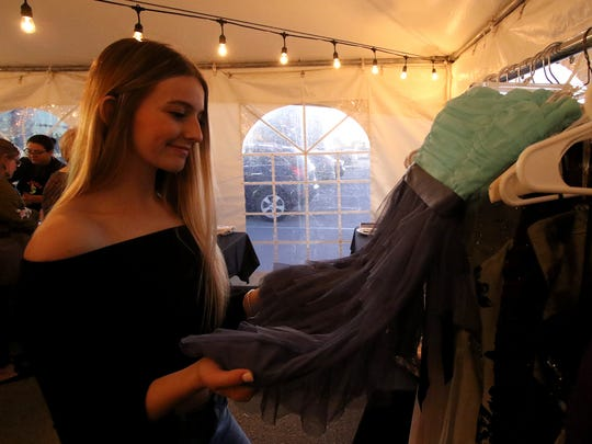 Addison Lobaugh looks at one of the donated dresses