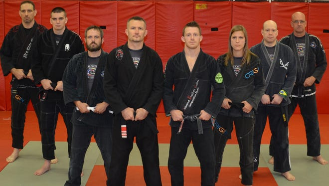 Team Chitwood competitors who represented a U.S. team at the World Council of Ju-Jitsu Organisations international championships: (left to right) Chris Tedjeske, Johnny Jardan, Vincent Cooper, coach Shawn Chitwood, Craig Chitwood, Katie Seher, Aaron Behr and Mark Whitman.