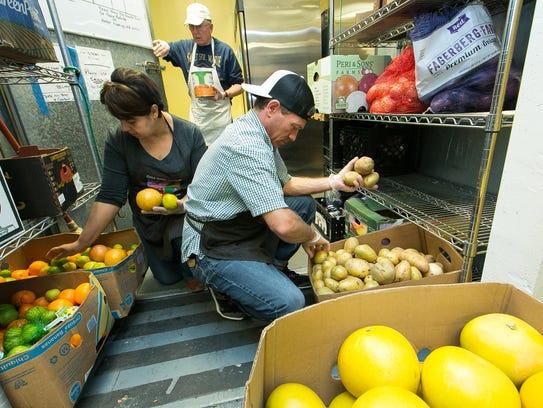 El Caldito Soup Kitchen volunteers Norma Rodriguez,