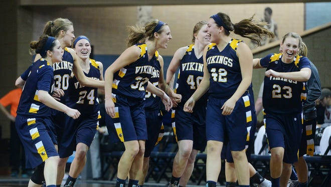 The Augustana women celebrate their 79-74 win over Minnesota State Moorhead  in Sunday's NSIC tournament quarterfinal game at the Sanford Pentagon, Feb 28, 2016.