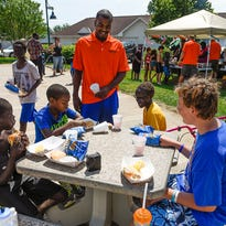Jerry Sparby is executive director of the Yes Network, which served lunch and played games with children Wednesday, July 20, at the Westwood Village Apartments.
