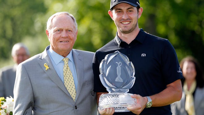 Jun 2, 2019; Dublin, OH, USA; Jack Nicklaus presents the trophy to Patrick Cantlay after winning the 2019 Memorial golf tournament at Muirfield Village Golf Club. Mandatory Credit: Joe Maiorana-USA TODAY Sports