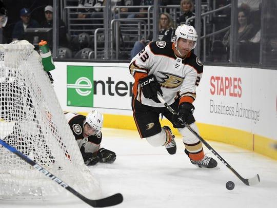 Ducks defenseman Francois Beauchemin (23) controls the puck behind the net during a preseason game.