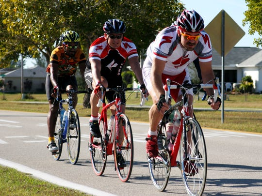 Cycling enthusiasts pedal down Agualinda Boulevard during the middle of a recent 100-mile Tour de Cape bike ride.