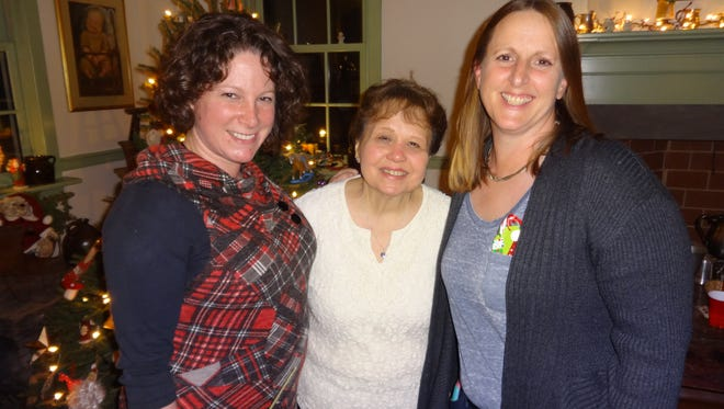 Stephanie Gamse, left of Hillsborough and Karen Kumpf, right, of Belle Mead were recently welcomed to the Jersey Harmony Chorus of Sweet Adelines International by membership chairwoman, Carole Auletta,of Bound Brook middle.
