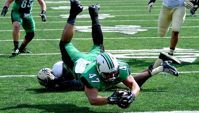 Marshall's Devon Johnson dives across the goal line for a touch down in there game with Purdue during an NCAA football game in  Huntington, W.Va., Sunday, Sept. 6, 2015. (AP Photo/Chris Tilley)