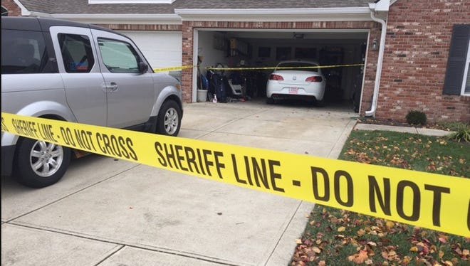 A garage door and an entry door were open at this house where a Johnson County man was found dead Friday, police said.