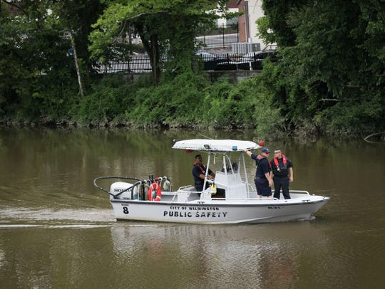 Wilmington firefighters search the Brandywine near